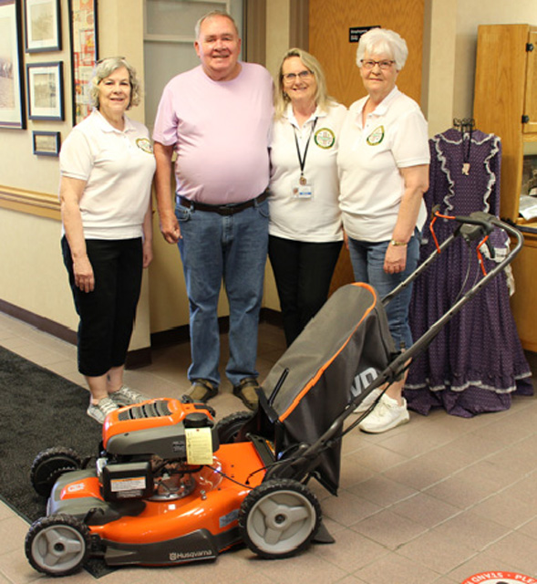 Winner of the Husqvarna push behind mower is Dinty Musk. Pictured with Dinty, left to right is commission members Jeanette Andre', Valarie Hinkle and Ellen Scharlach.